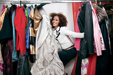 Woman posing with clothes